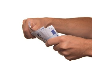 a person holding a money