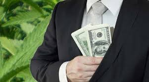 a man holding a money on his chest
