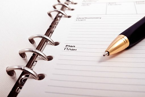 plan note written on a notebook
