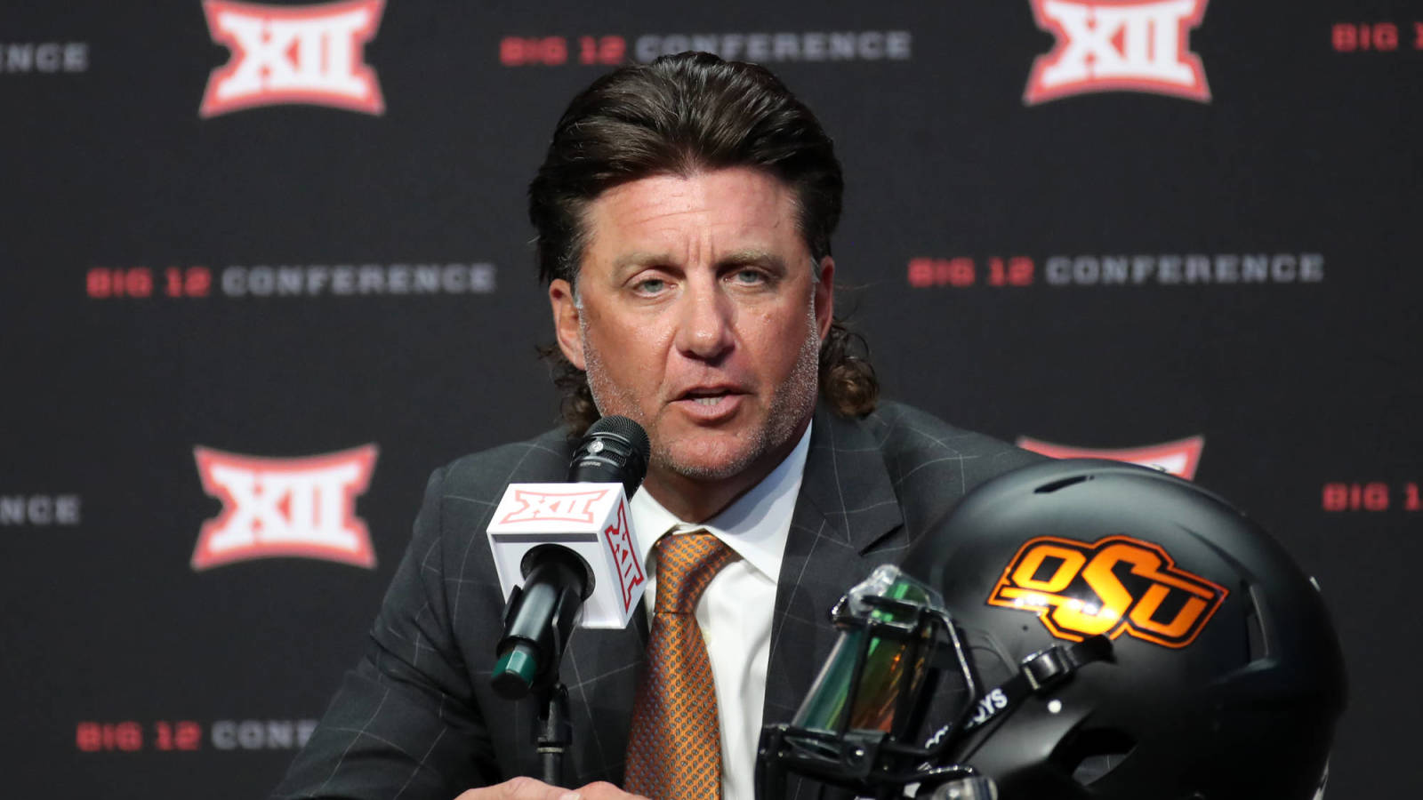 Photo of Oklahoma State's Mike Gundy takes $1 million pay minimize following investigation
