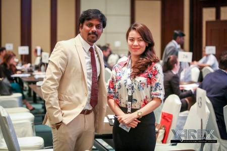 A young couple posing for a photograph during a conference Bangkok Thailand