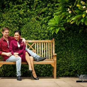 Well Dressed Smiling Couple on a Bench