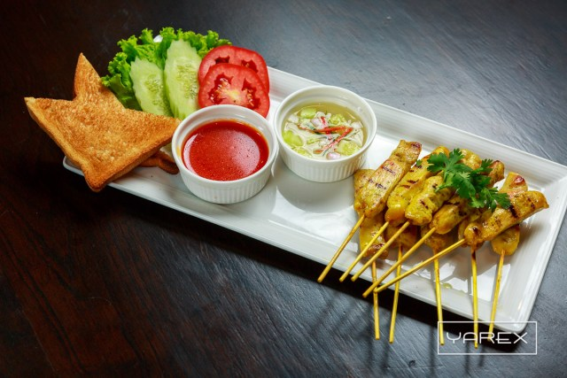 Food Photography at O'Malley's Restaurant - Thai spicy satay. Bangkok, Thailand
