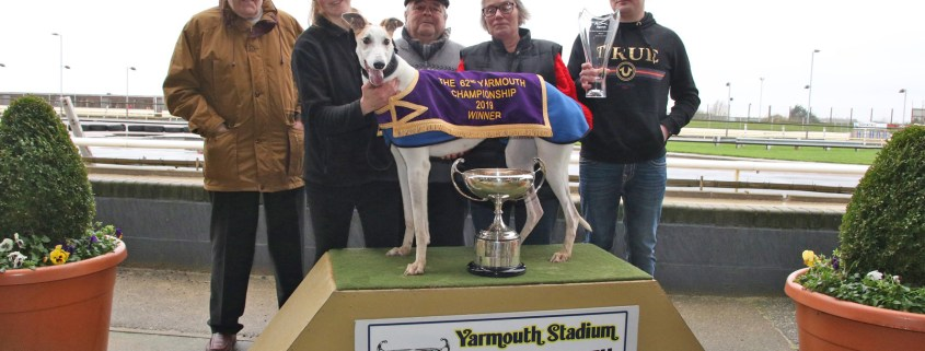 Winner of the 62nd Yarmouth Championship at Yarmouth Stadium. In the Presentation Photo from the left to right - Eric Brown, Head Kennel Hand Chloe Fairman holding the Winner Jakes Magic, Roland Samuels, Trainer Erica Samuels and on the right Ryan Fairman.