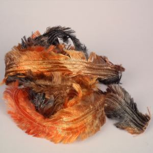 Chunky space dyed feather yarn on cone black orange