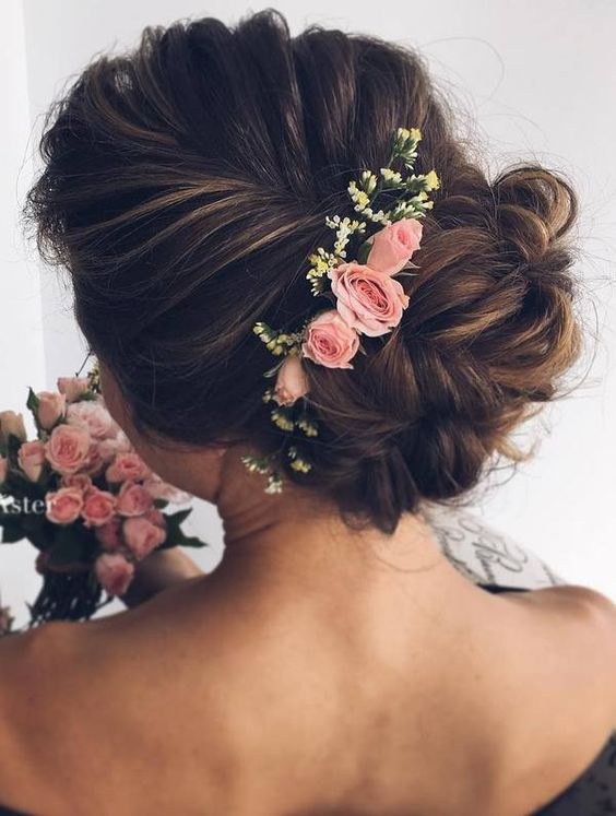 Hairstyle with a bunch of flowers