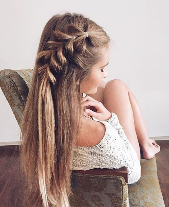 Fashionable hairstyle in the photo, decorated with a volumetric braid