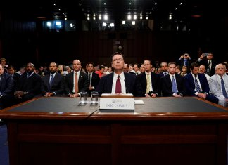 Former FBI Director Comey testifies before a Senate Intelligence Committee hearing in Washington