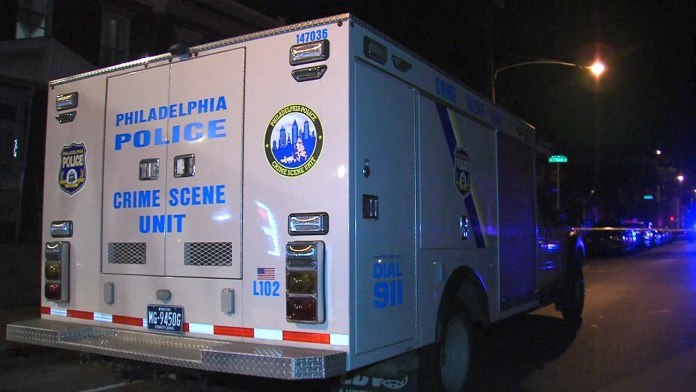 Philadelphia Crime Scene Investigators on the scene of a suspicious body located. (YC.NEWS/ERIC NORTON)