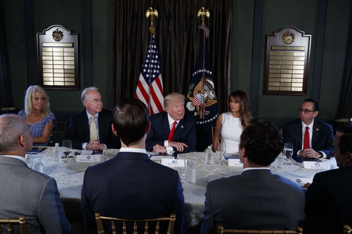 President Donald Trump speaks during a briefing on the opioid crisis, Tuesday, Aug. 8, 2017, at Trump National Golf Club in Bedminster, N.J. From left are, White House senior adviser Kellyanne Conway, Health and Human Services Secretary Tom Price, Trump, and first lady Melania Trump. (AP Photo/Evan Vucci)