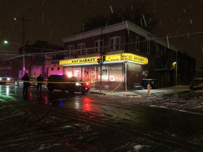 Police on scene of a double shooting outside of a Chester City market. (YC.NEWS PHOTO/NIK HATZIEFSTATHIOU)