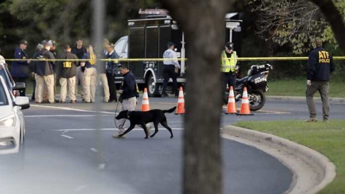 Officials work and stage near the site of Sunday's deadly explosion, Monday, March 19, 2018, in Austin, Texas. Police warned nearby residents to remain indoors overnight as investigators looked for possible links to other package bombings elsewhere in the city this month. (AP Photo/Eric Gay)