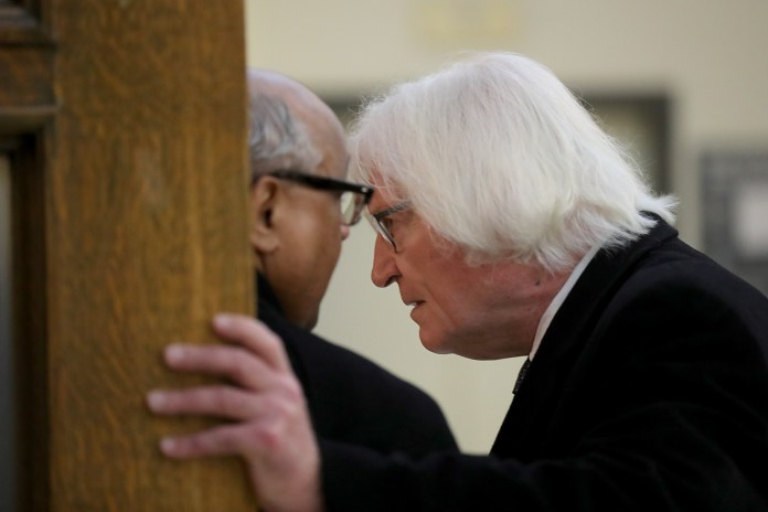 Lawyer for actor and comedian Bill Cosby, Tom Mesereau, right, talks to an unidentified member of the defense team during the second day of Cosby's sexual assault retrial at the Montgomery County Courthouse in Norristown, Pa. on April 10, 2018. ( David Maialetti /The Philadelphia Inquirer / Pool Photo )