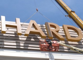 This Friday, May 4, 2018 photo shows part of the first sign for the soon-to-open Hard Rock Casino in Atlantic City N.J., being lifted into place on the building. As Atlantic City's casinos mark their 40th anniversary, the industry is hailing the reopening of two of the five casinos that shut down since 2014, though some worry that re-expanding the market could lead to the same conditions that caused the closings in the first place. Hard Rock, which is the former Trump Taj Majal, and Ocean Resort, which is the former Revel, are both due to open on June 28. (Wayne Parry/Associated Press)