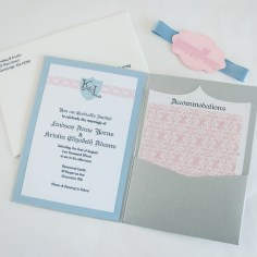 Inside, the pattern from the envelope is carried through to the back of the RSVP postcard and echoed as an accent to the custom monogram.