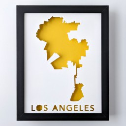 Framed map of Los Angeles, California cut out of white paper to reveal a yellow background