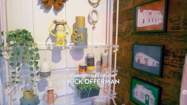 """A still from the """"Making It"""" title sequence showing various handmade objects and plants decorating the inside of the barn, where the show is filmed and the words """"Executive Producer Nick Offerman"""""""