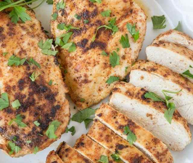 Juicy Stovetop Chicken Slice On A Plate With Parsley