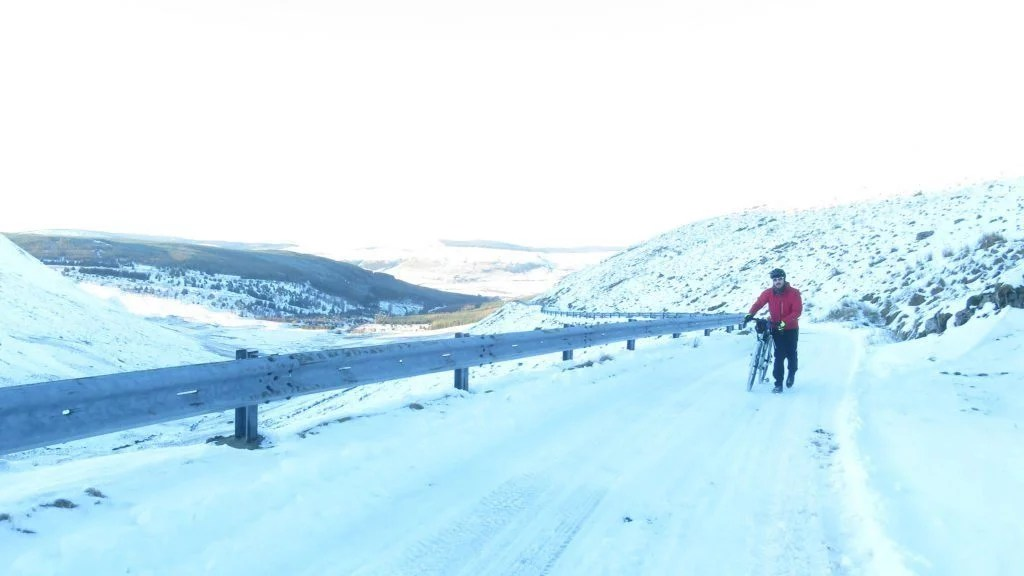 Bicycle touring cycling in Scotland snowy-road-Bikepacking scotland