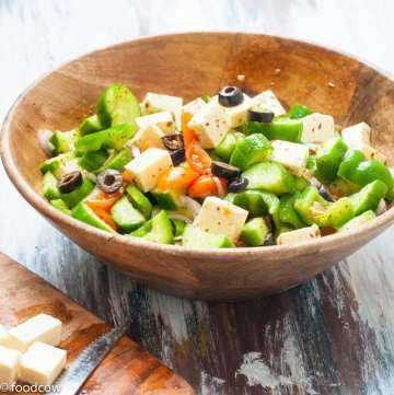 Authentic Greek salad - made with cucumbers,tomoateos and Bell pepper with a simple dressing or dried oregano,olive oil and lime juice.