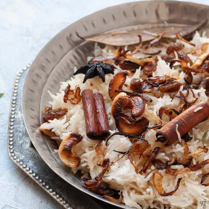 Ghee Rice Recipe - Flavourfull special occasion Rice dish made with nuts,fried onions and ghee! A Gluten Free Vegetarian instant pot & stove top recipe!