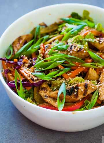 Asian Grilled Chicken Salad in Peanut butter & Chilli Dressing - Low calorie, dairy free,Gluten Free Salad recipe with an asian inspired dressing. #salad #asiansalad #chicken #chickensalad #peanutbuttterdressing #peanutbutter #chickentenders