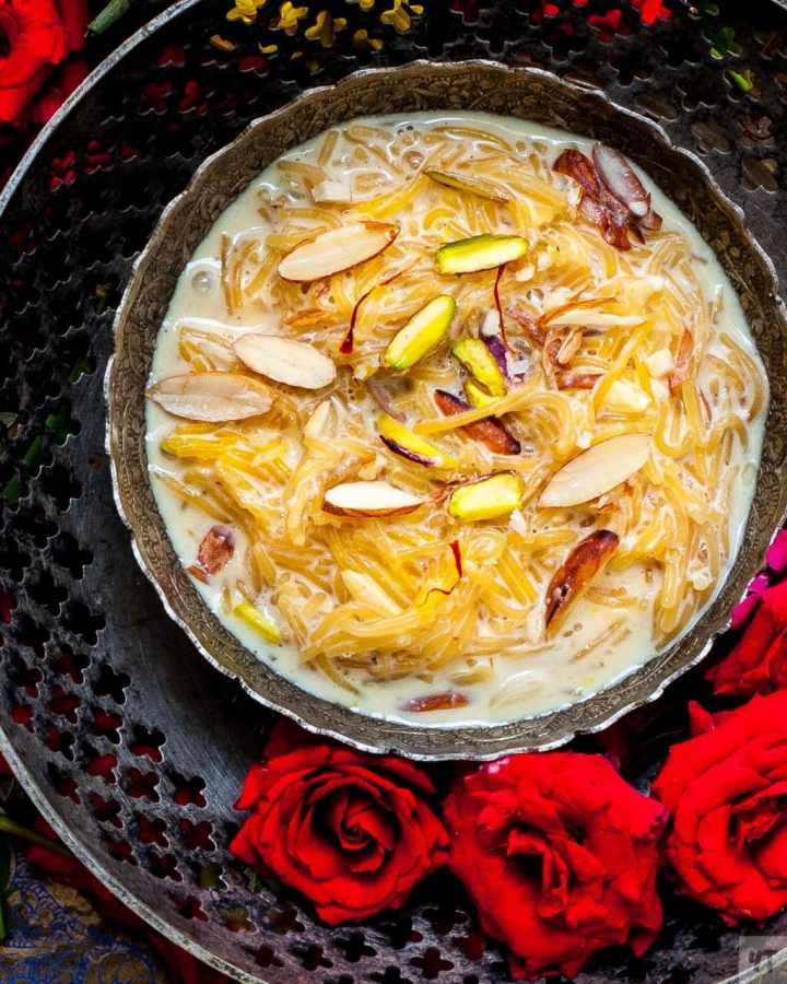 Instant Pot Vermicelli Kheer - Semiya Payasam or Sev ki Kheer in a silver bowl with pistachios, almonds and saffron as garnish.