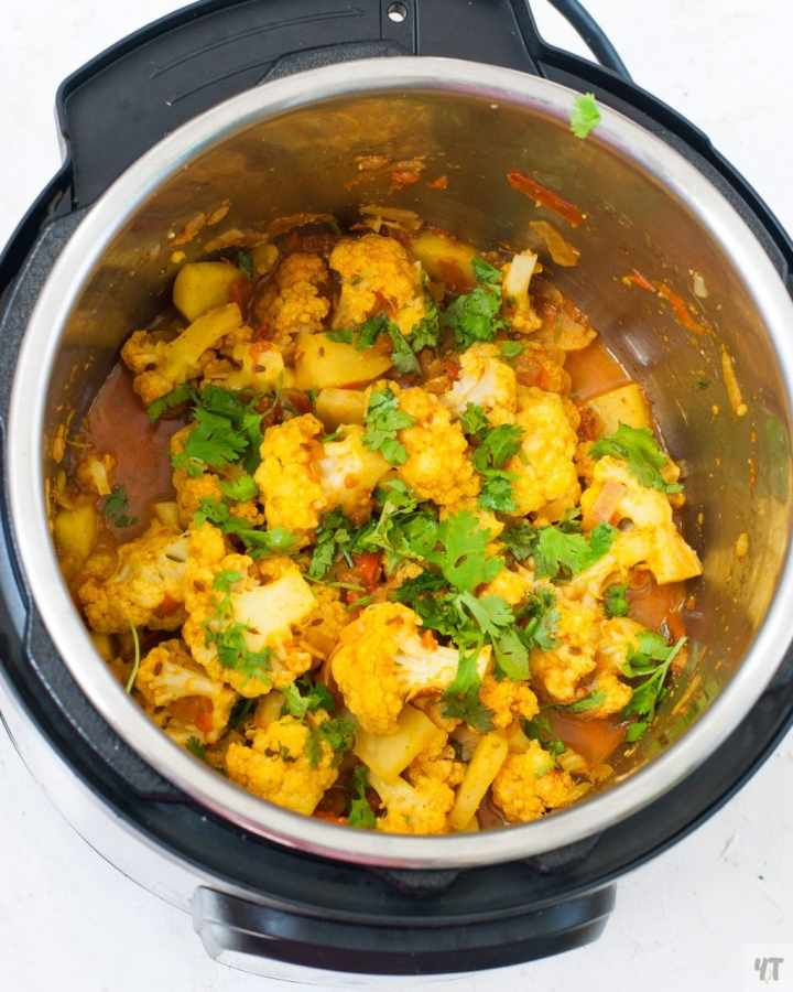 Aloo Gobi in instant pot top view.Potatoes and cauliflower in instant pot.