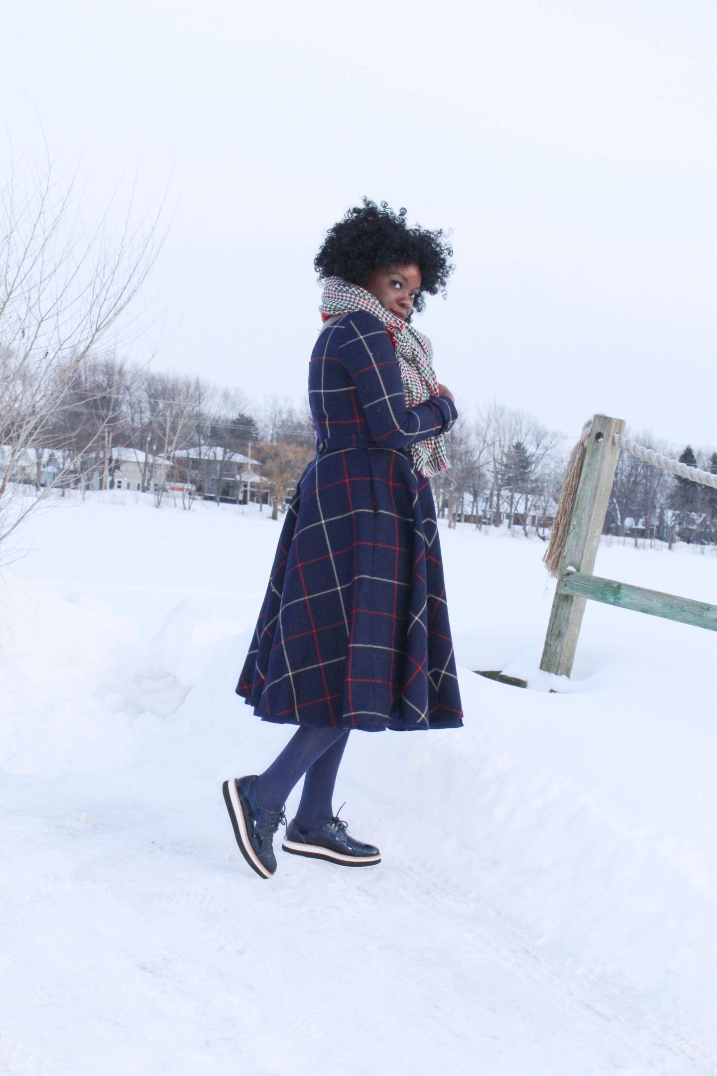 Blue tweed dress by a frozen lake