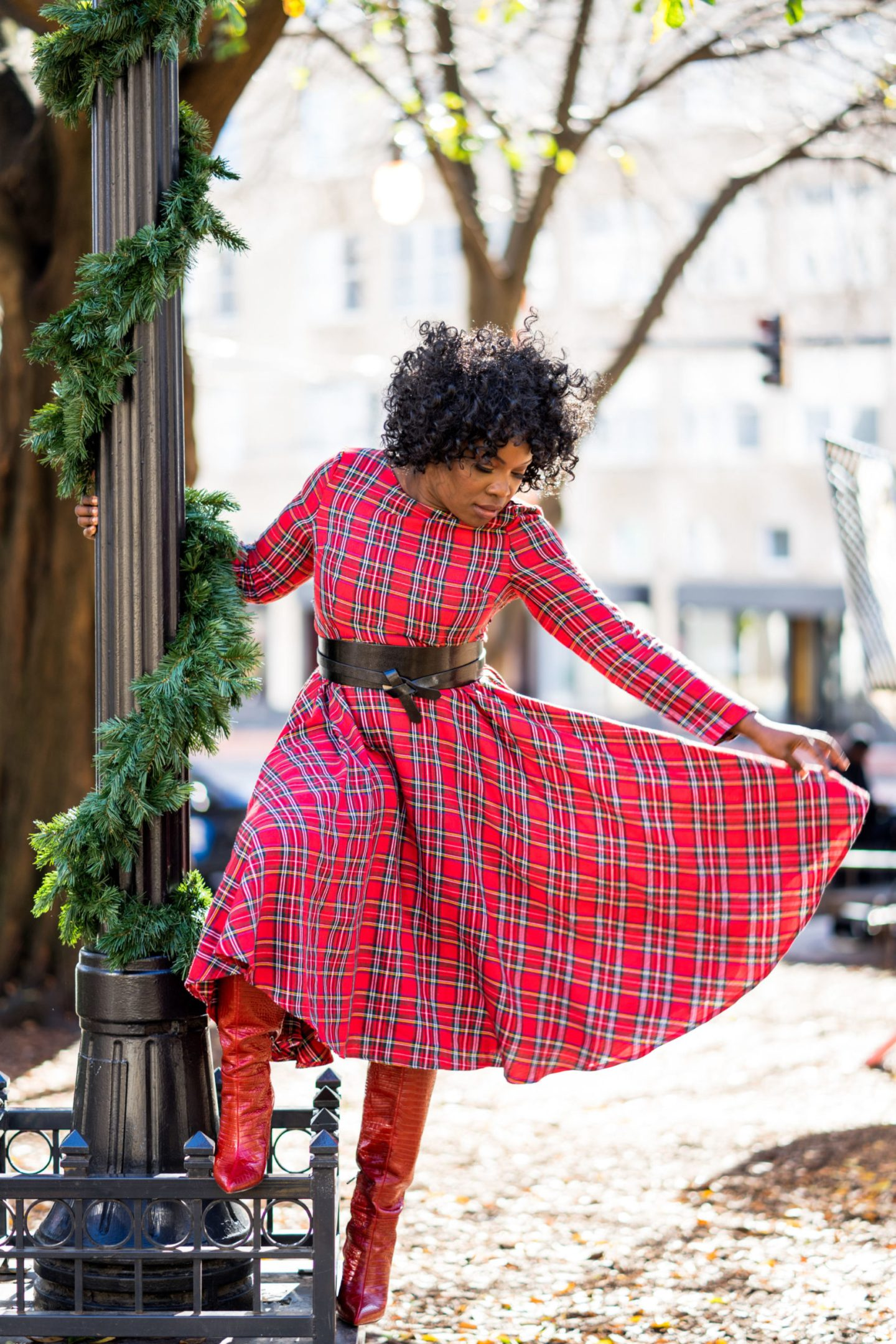 Girl wearing plaid thrift dress in Woodruff Park