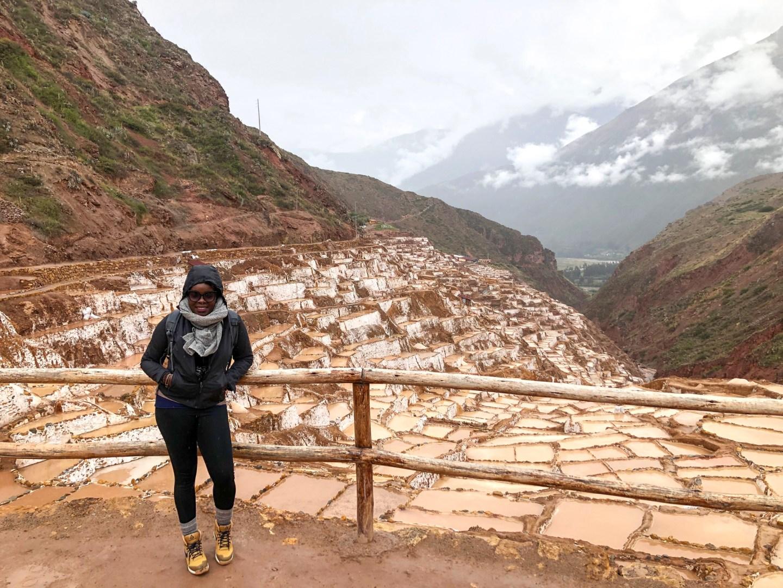 Black travel blogger at Las Salinas De Maras in Peru