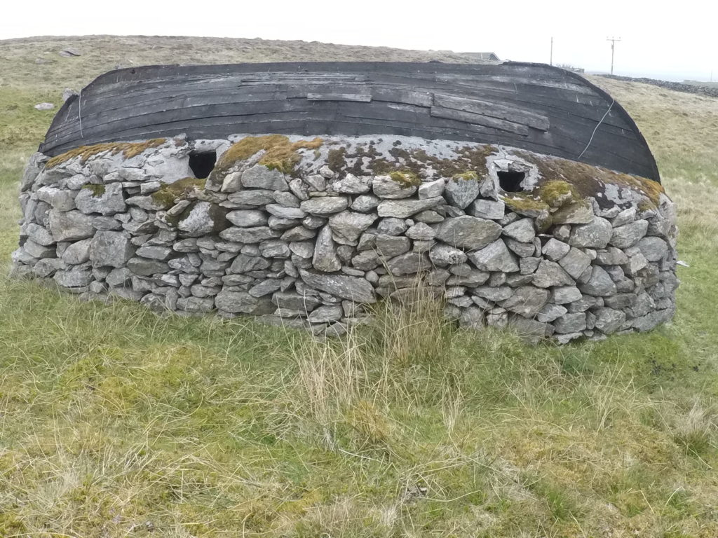 A boat used as a roof in Whalsay - hiking in Shetland
