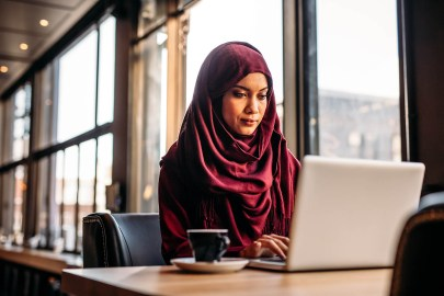 Businesswoman in hijab working on laptop