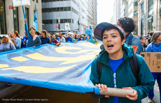 The author marches in the Flood Wall Street demonstration. Photo by Shadia Fayne-Wood / Project Survival Media.