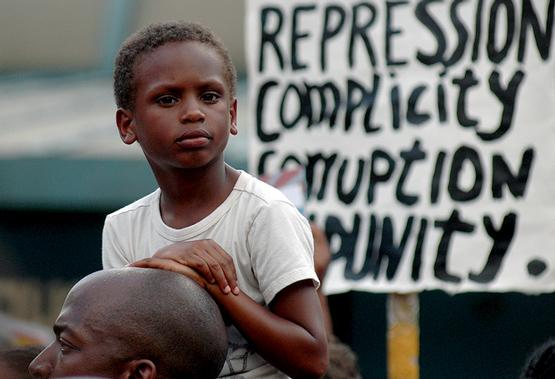 Boy at demonstration for Trayvon Martin