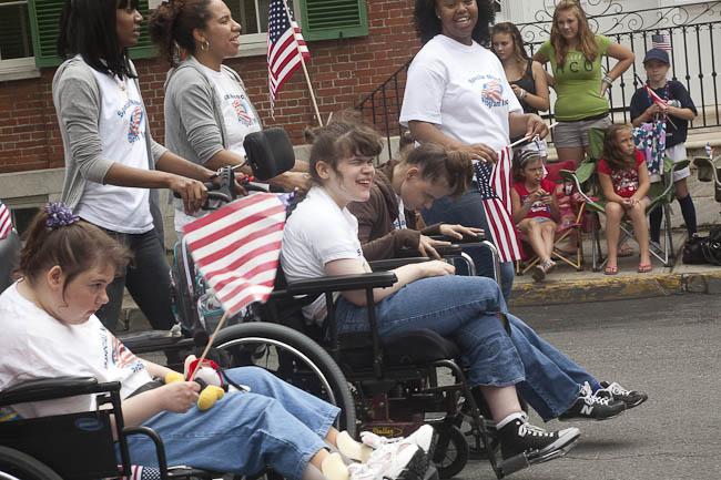 three girls in wheelchairs