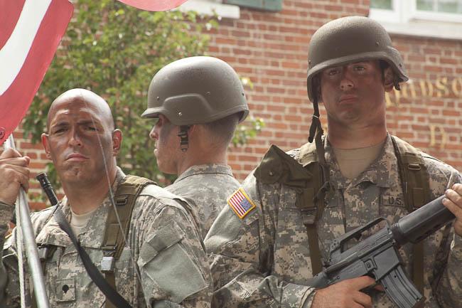 contemporary soldier reenactors on float