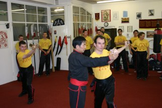 Sifu Hepple being taught by Yee Chi Wai. 28 May 2005. Aberdeen