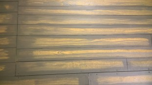 A close-up of the painted floorboard detailing.
