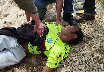 Bassem Abu Rahmeh after being hit by an Israeli tear gas cannister
