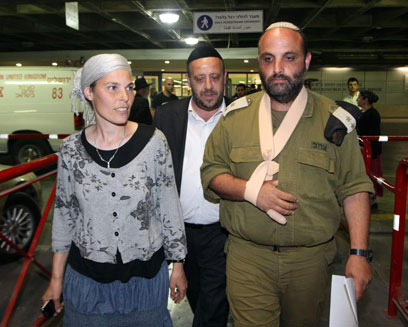 Col. Shalom Eisner and wife leaving hospital