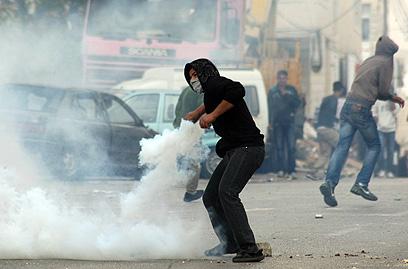 """עימותים ביהודה ושומרון במהלך מבצע """"עמוד ענן"""" (צילום: AFP)"""