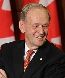The photo depicts Joseph Jacques Jean Chrétien-a leader of the Liberal Party of Canada from 1990 to 2003, and the Prime Minister of Canada from 1993 to 2003- looking away and smiling.