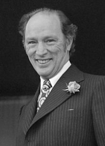 The photo depicts Joseph Philippe Pierre Yves Elliott Trudeau-a leader of the Liberal Party of Canada and the Prime Minister of Canada from 1968 to 1984 (with a brief period as Leader of the Opposition between 1979 and 1980)- smiling at the camera.