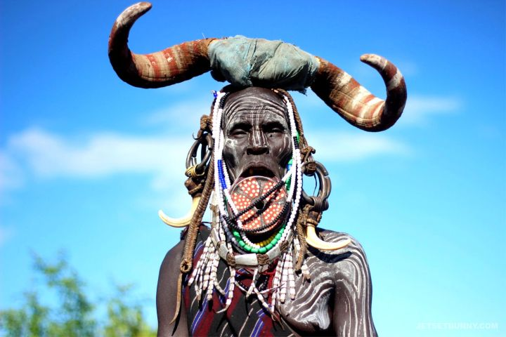 Portrait of a Mursi woman wearing the symbolic clay plate they are famous for
