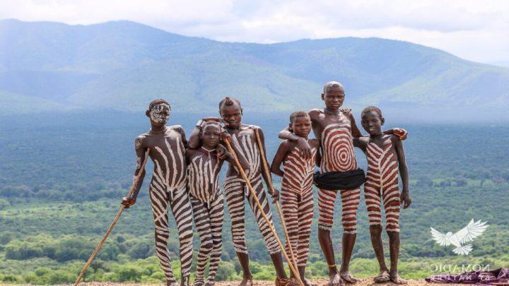 Young Boys Mursi Tribe of Ethiopiawith zebra print on their body