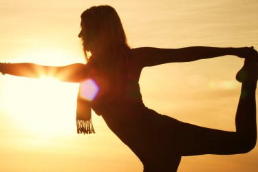 yoga woman sunset