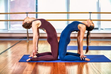 Partner yoga pose - Double Camel Pose