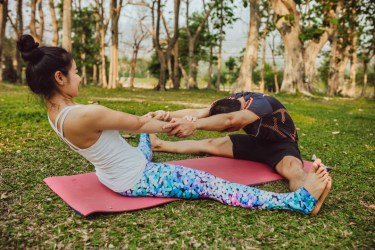 Partner yoga pose - Seated Wide-Legged Forward Fold