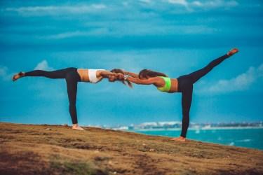 Partner yoga pose - Double Warrior III Pose